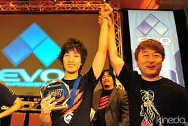 Street Fighter Producer Yoshinori Ono (r) raising the hand of Evolution 2010 champion Daigo Umehara.  Evolution is annually the largest fighting game tournament in America.